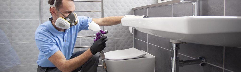 Man repairs bathroom sink and basin