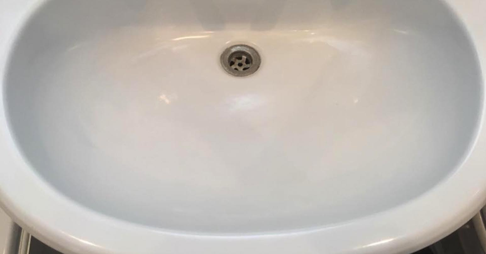 Damaged bathroom sink - After repairing hole