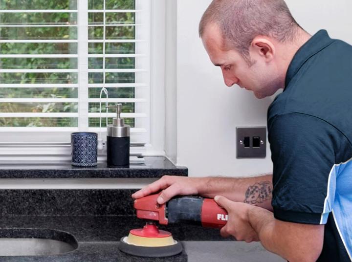 Finisher restoring a kitchen worktop
