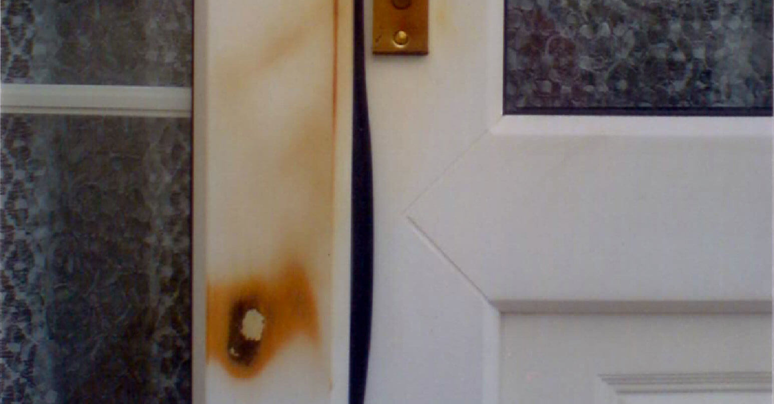 Burnt UPVC door frame - Before repair