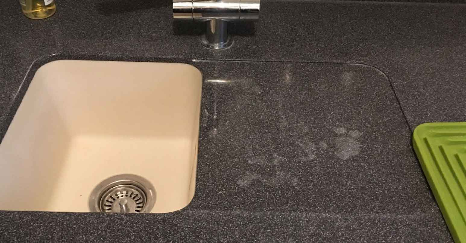 Stained corian composite worktop sink draining board
