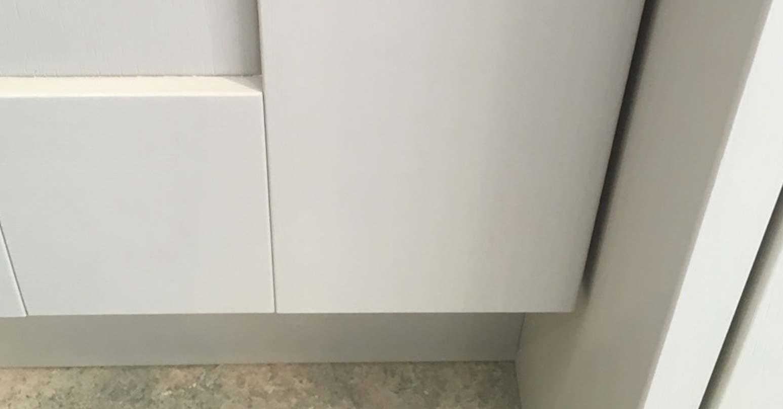 Damaged cupboard door - After repair
