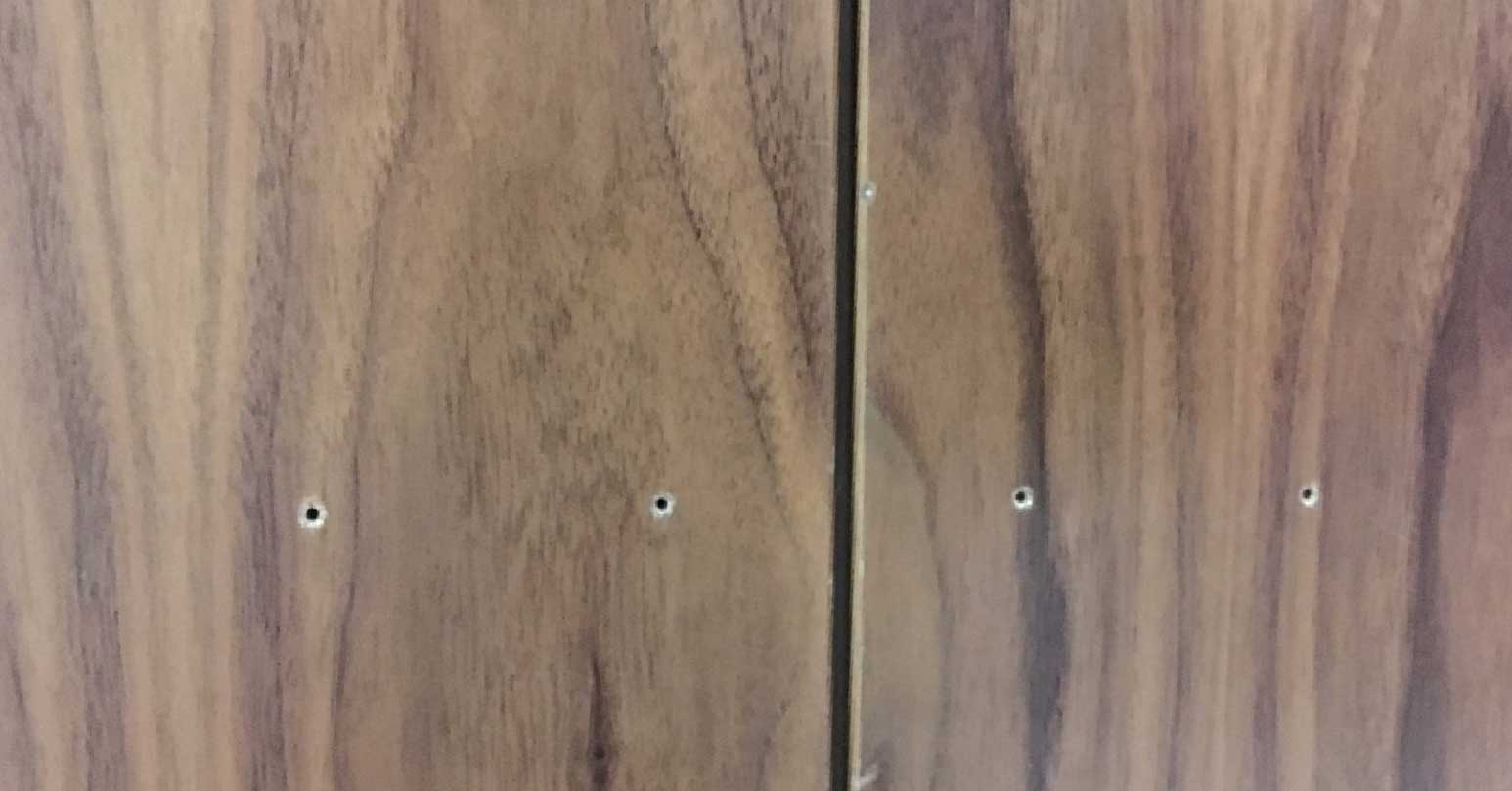 Holes in laminate door