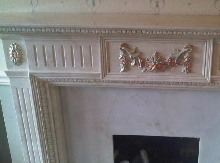 Repair to damaged plaster fireplace