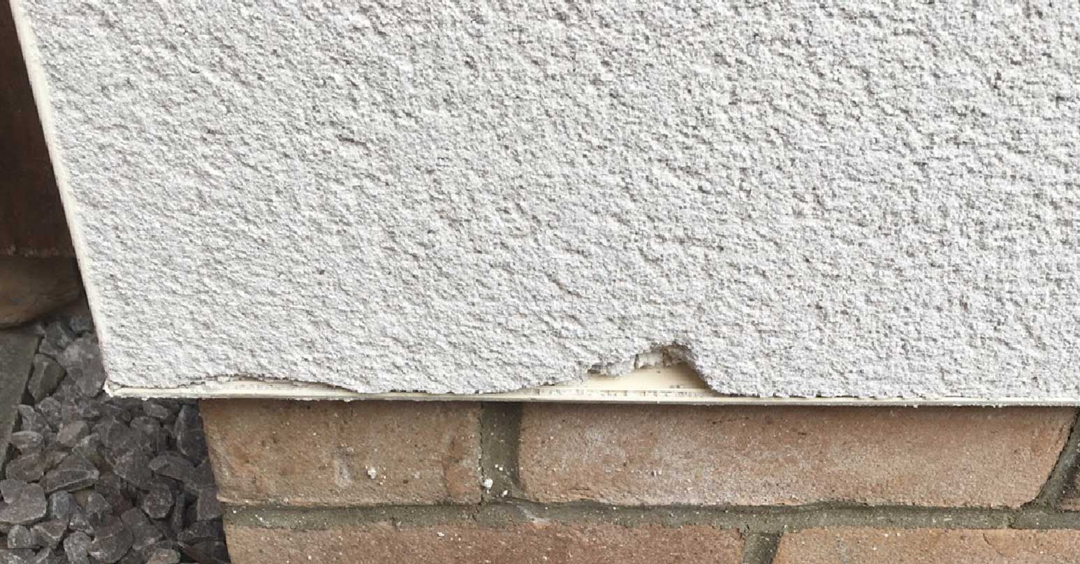 Chipped render wall repair
