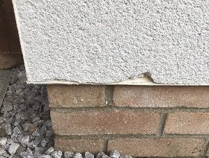 Chipped render wall