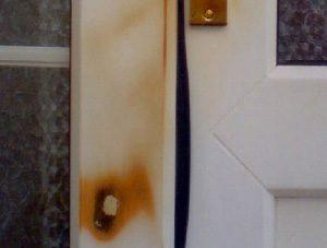Burnt uPVC door frame