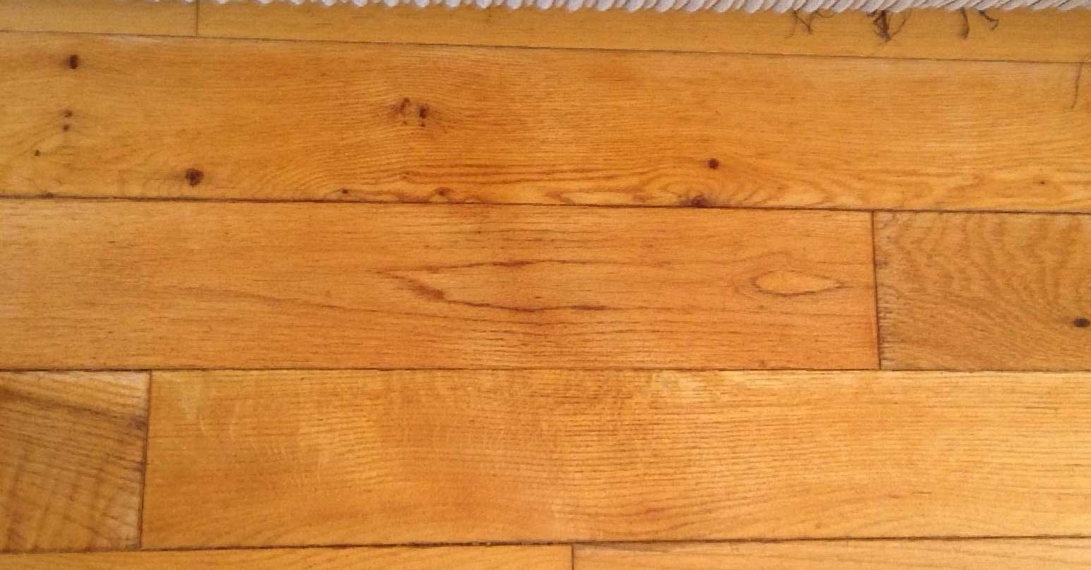 Repaired stain to solid wood floor