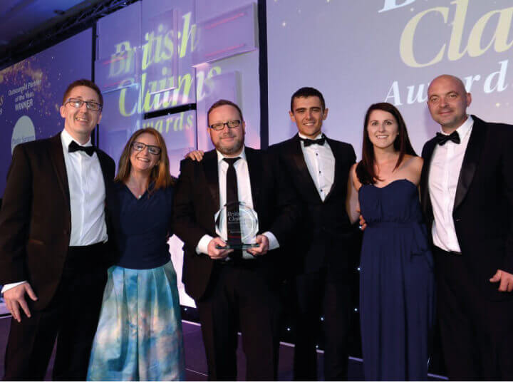 Plastic Surgeon team collecting their award at the British Claims Awards