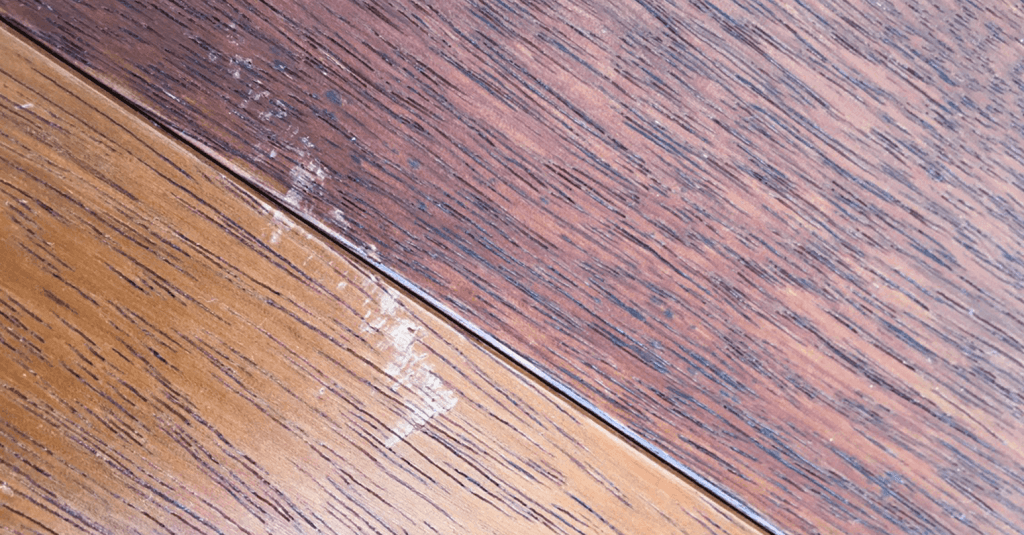 Scuffed laminate flooring - Before repair