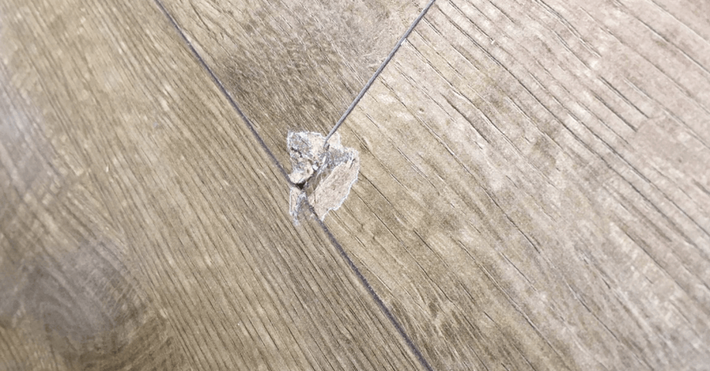 Dented laminate flooring - Before repair