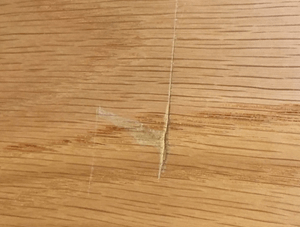 Scratch on wooden cupboard