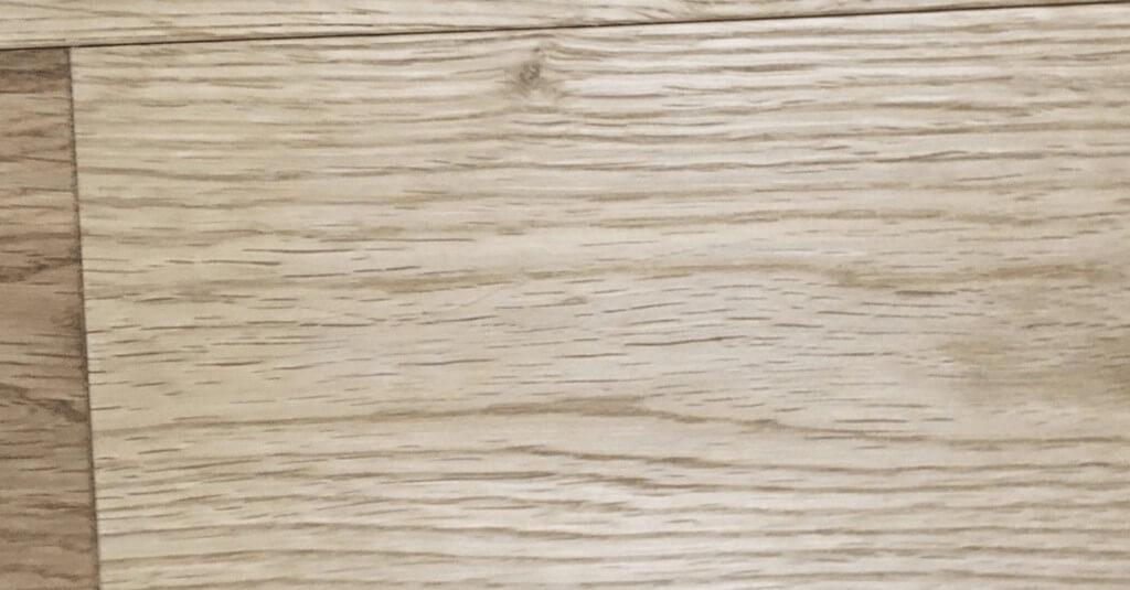 Screw showing on wooden floor - After repair