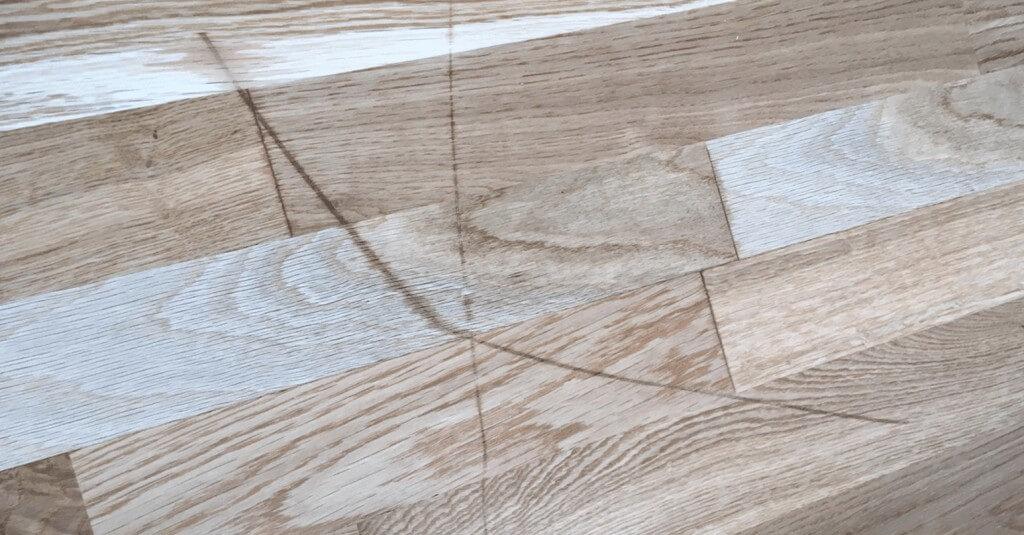 Scratched wooden floor - Before repair